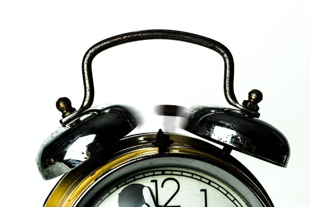 An alarm clock ringing.